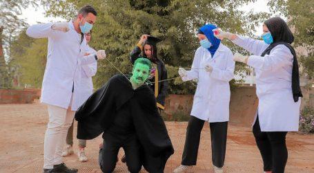 """""""الأرض ضد كورونا"""".. فوتوسيشن لشباب قنا للتوعية بجهود الدولة ضد الفيروس المستجد (صور)"""